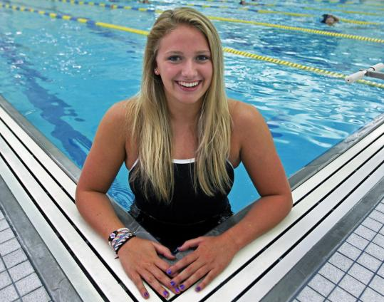 Erica Belcher, at Reading's Burbank Y, swims nearly 35 hours a week.