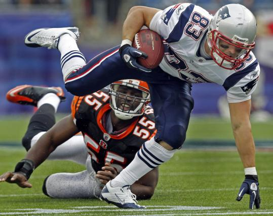 Bengals linebacker Keith Rivers can only watch as the Patriots' Wes Welker scrambles away for additional yardage.
