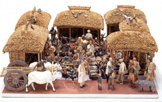 This sculptural rendering of a bazaar in Calcutta was made of unfired clay in the late 19th century in India.
