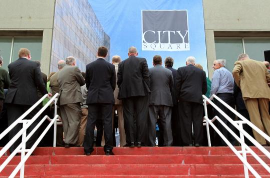 Hundreds of onlookers joined state officials and business leaders yesterday to mark the beginning of work on the CitySquare project in Worcester.