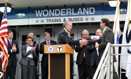 US Representative Edward J. Markey shook hands with Mayor Thomas G. Ambrosino of Revere yesterday after delivering comments at the groundbreaking for an MBTA parking lot that will clear the way for a hotel and residential development.