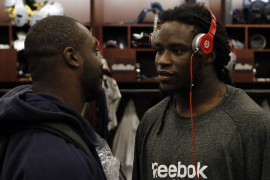 Laurence Maroney (right), who is hoping to get in rhythm on and off the field, chats with Darnell Jenkins.