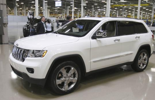 Chrysler revealed updated models at a closed-door meeting yesterday, though it didn't release photos. Despite demand for smaller vehicles, the company's sales still rely on trucks like the 2011 Jeep Grand Cherokee, which arrived at dealers in June.