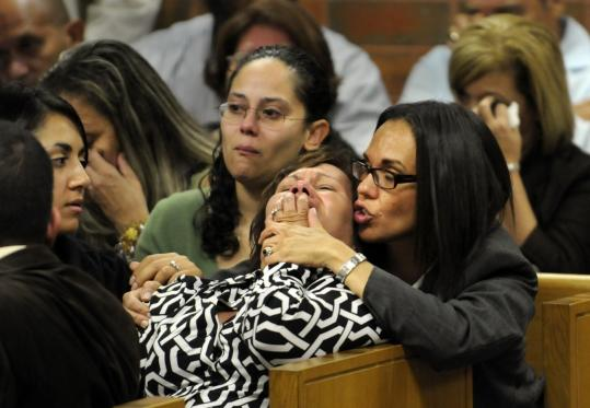 Maria Perez, wife of Eddie Perez, the former mayor of Hartford, was overcome during her husband's sentencing yesterday. She was comforted by her sister-in-law.