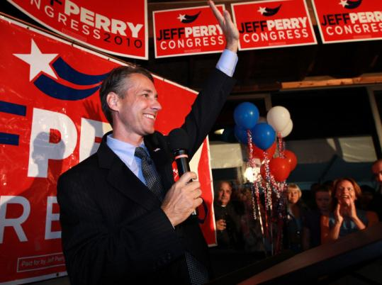 Republican Jeffrey D. Perry (left) waves to his supporters at his victory celebration at Plimoth Plantation last night.