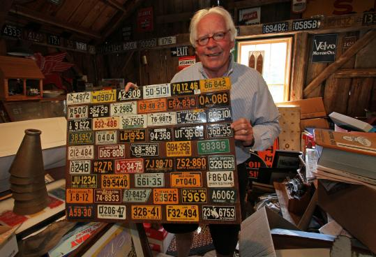 Bob English holds a 50-state (plus D.C.) collection of license plates thate were once given away in cereal boxes.