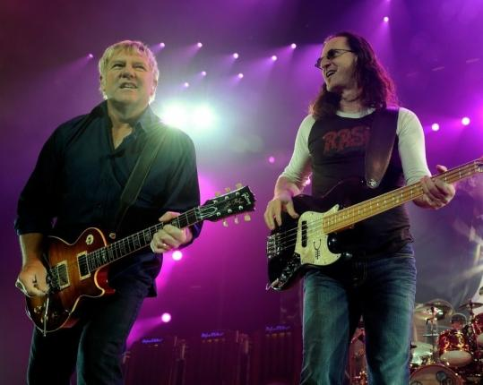 Ethan Miller/Getty Images Rush's Alex Lifeson (left) and Geddy Lee (shown in August in Las Vegas) unveiled two new songs Tuesday night at TD Garden.