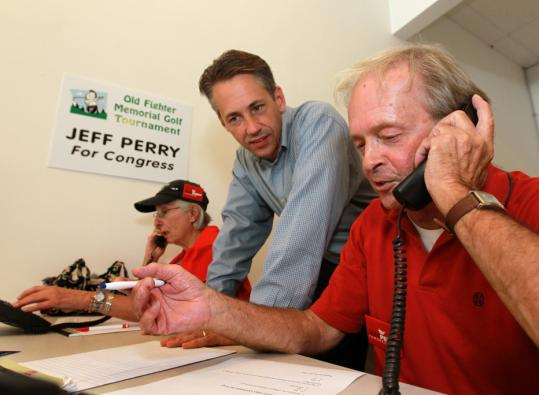 Jeffrey D. Perry (middle), the Republican primary winner, visited with volunteers at his Sandwich campaign office yesterday.