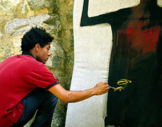 A scene from Tamra Davis's documentary about Jean-Michel Basquiat, a New York graffiti artist who became a painter.
