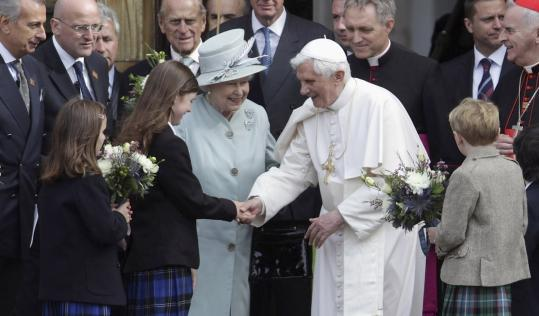 Pope Benedict XVI and Britain's Queen Elizabeth II greeted students yesterday in Edinburgh, where many waved Scottish flags.