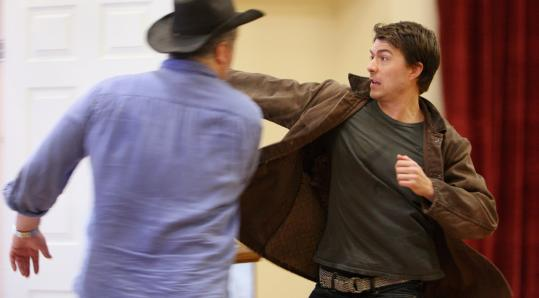 Noah Bean (right) and Adam LeFevre rehearse a fight scene for the Huntington Theatre Company's production of 'Bus Stop.'