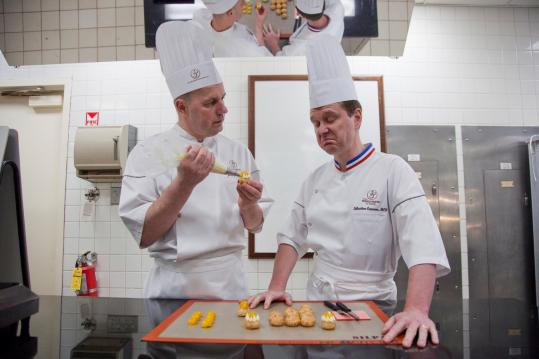 "Jacquy Pfeiffer (left) and Sebastien Canonne at the pastry school they founded in Chicago. Pfeiffer is the subject of filmmakers Chris Hegedus and D.A. Pennebaker's documentary ""Kings of Pastry,'' about a French competition Pfeiffer entered."
