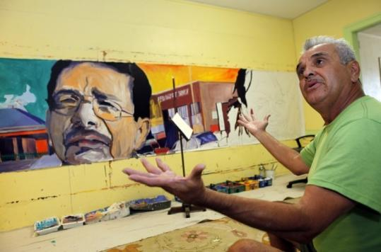 Ernesto de la Loza, sitting in his studio in the Echo Park area of Los Angeles, bemoans the fact that so many of his murals have disappeared. His artwork depicts Angeleno life.