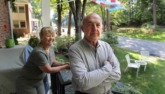 Janet and Tom Kinch have a clear view of the neighborhood from their home, once the quarters for an Army colonel at Fort Devens, but they are disappointed at the lack of progress in creating a new community on the old military base in the seven years since they bought the property.