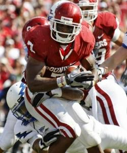 Oklahoma running back DeMarco Murray is wrapped up by Air Force's Jon Davis in the second quarter.