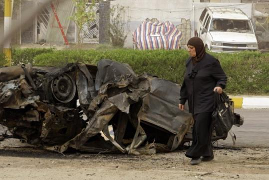 The car bomb that exploded in western Baghdad killed at least 10 people. Dozens more died in two other attacks in Iraq.