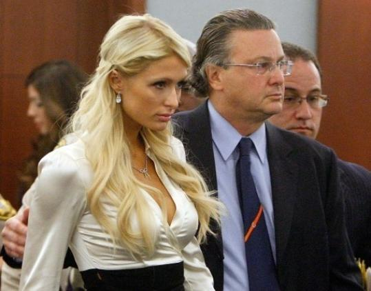 Paris Hilton, accompanied by her attorney David Chesnoff, in court yesterday.