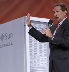 Mark Hurd, ousted as Hewlett-Packard's CEO, is now copresident at Oracle. He spoke at a company conference yesterday but did not address the tensions between the companies.