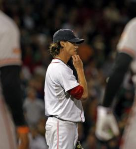 Clay Buchholz, cruising with a shutout in the sixth inning, watches a pop fly fall for an error that led to a run in the frame.