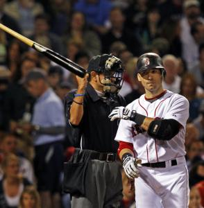 Umpire Alfonso Marquez rings up Marco Scutaro, and the Sox shortstop lets the bat fly.