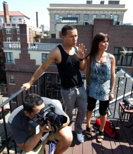 Ricardo Rodriguez works with designer Daniela Corte and photographer Dominic Costa at a photo shoot on a Beacon Hill rooftop.