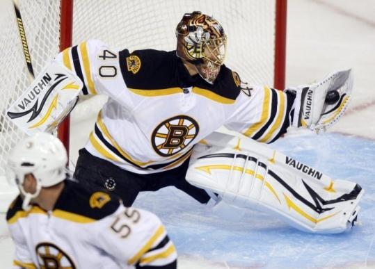 Bruins goalie Tuukka Rask flashes some midseason form, making a glove save in last night's 4-2 preseason win at Montreal.