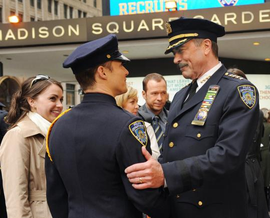 "Tom Selleck (right) plays the father of a newly minted cop (Will Estes) in ""Blue Bloods.''"