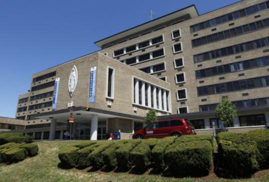 Carney Hospital in Dorchester (above) and St. Elizabeth's Medical Center in Brighton could be closed if Caritas Christi Health Care can't close a deal with a New York equity firm to sell the chain, according to two people who attended contract talks last week.