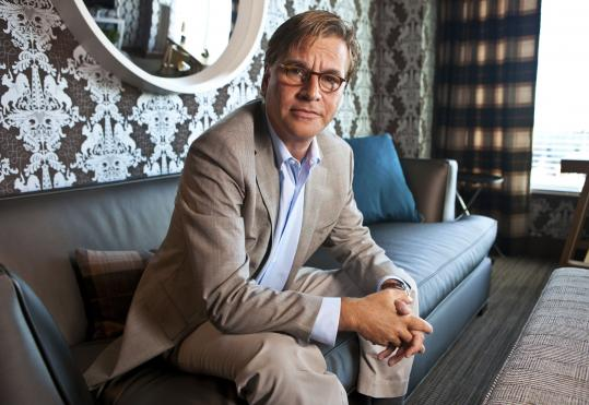 Aaron Sorkin describes 'The Social Network' as 'several versions of a true story.'