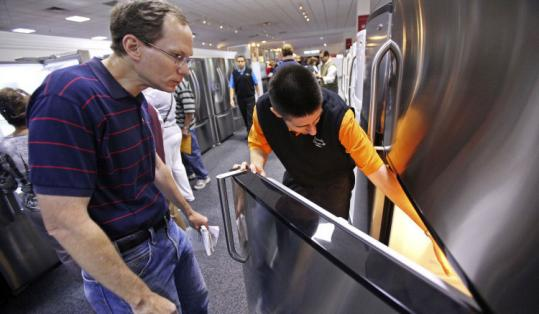 A man shopped for a refrigerator at the ABT store in Glenview, Ill. The demand for durable goods fell 1.3 percent in August.