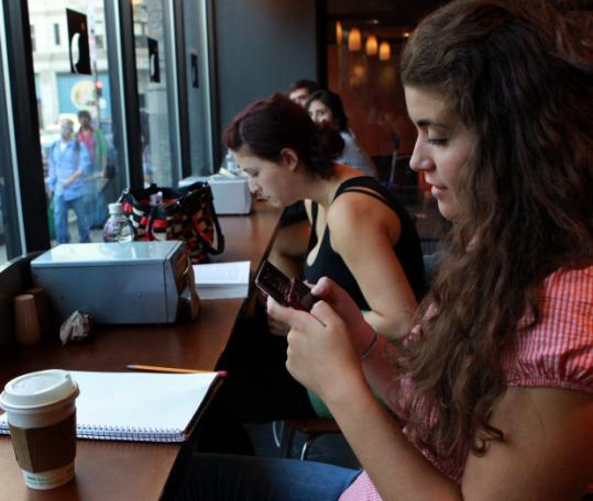 Leanne Bowes, who studies marketing at Emerson College, texted on her cellphone in a Boston cafe.