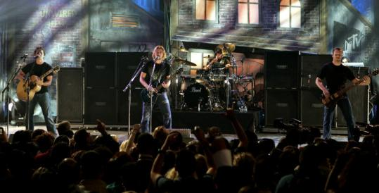 Nickelback brings two modes, metallic grind and power ballad, to the stage.
