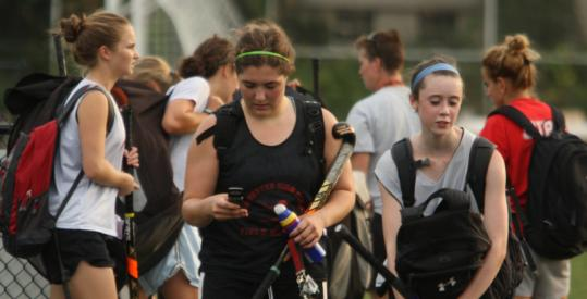 Alexis Zavez was sending texts after field hockey practice Friday.