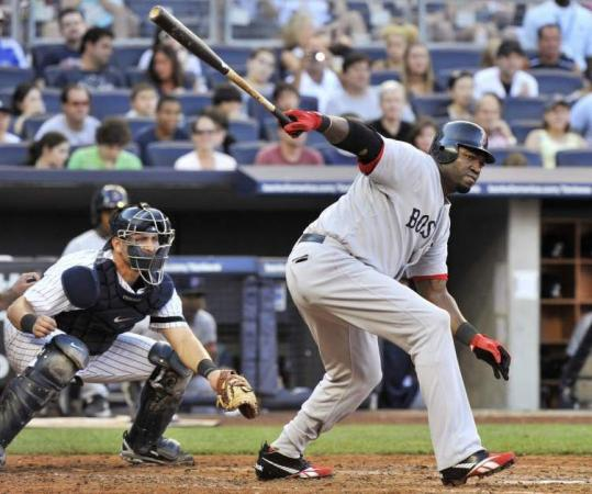 David Ortiz follows through on his swing as he singles to drive in a run against the Yankees in the third inning yesterday.