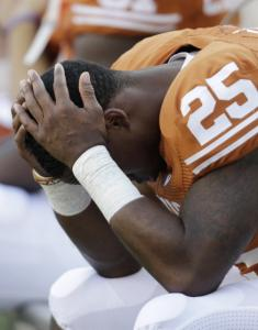 Longhorns running back Jeremy Hills can't bear to watch as UCLA finishes off its upset of Texas.