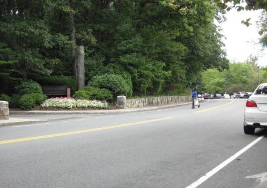 A woman walked across Perkins Street to the Cabot Estate recently. Condo residents want the crossing to be made safer.