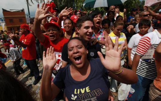 Supporters of President Hugo Chavez of Venezuela cheered him outside the polling station in Caracas where Chavez cast his vote during congressional elections.