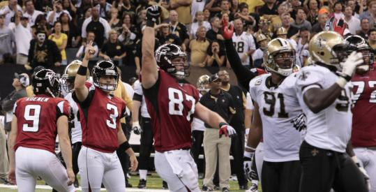 The Falcons get to celebrate on the floor of the Superdome after Matt Bryant (3) nailed the winning field goal in overtime.