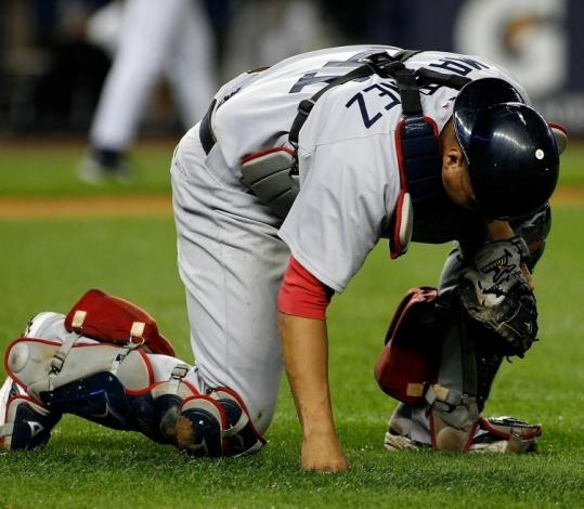 Sox catcher Victor Martinez was downcast after committing a throwing error on Brett Gardner's 10th-inning bunt.