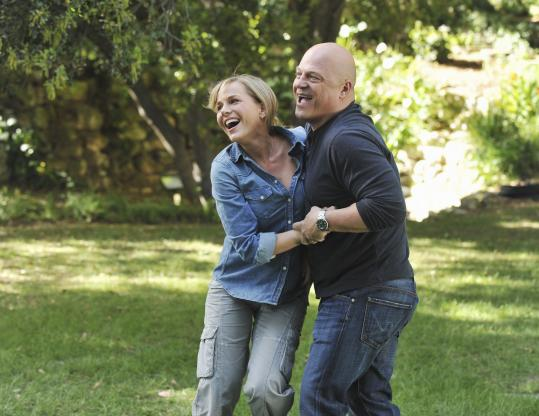 "Julie Benz and Michael Chiklis as a couple with superpowers in the new ABC series ""No Ordinary Family.''"