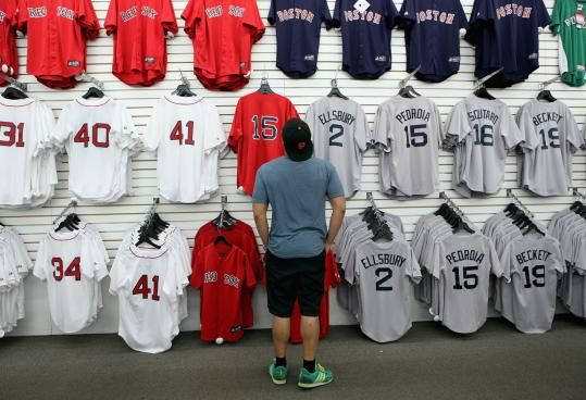 Elwin La Pietra looked for a Dustin Pedroia jersey at the Red Sox Team Store on Yawkey Way early this month.