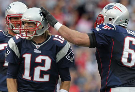 Stephen Neal (right) and the offensive linemen appreciate Tom Brady's playmaking ability.