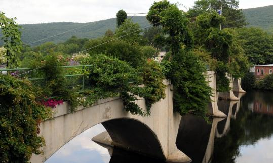 The Bridge of Flowers was conceived by a Shelburne Falls women's group in 1929, the year after the bridge was no longer used to convey trolley cars across the Deerfield River. The 400-foot-long garden has bloomed spring to fall ever since.