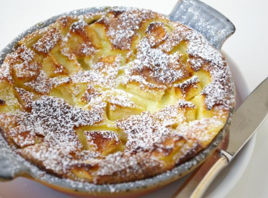 Apple clafoutis is a creamy delight.