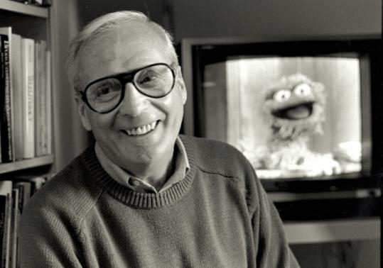 "Gerald Lesser, a professor at the Harvard Graduate School of Education, developed the curriculum for ""Sesame Street.'' Below, Dr. Lesser on the set with Kermit the Frog. (©Susie Fitzhugh)"