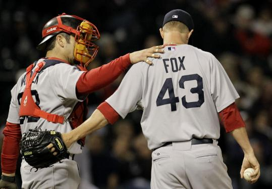 Catcher Jason Varitek consoles reliever Matt Fox, who allowed the winning run in ninth inning.