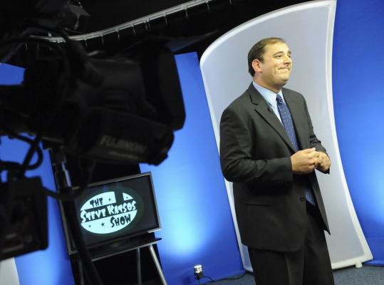 Steve Katsos awaits his cue during a recent taping in Arlington Community Media Inc.'s studio; his show is seen in a dozen states.