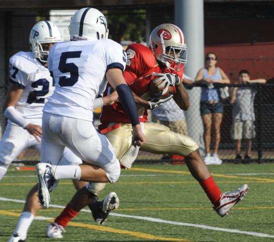 Everett&#8217;s Manny Asprilla (2) scores against St. John&#8217;s Prep&#8217;s Lucas Bavaro (5) and Alex Moore.