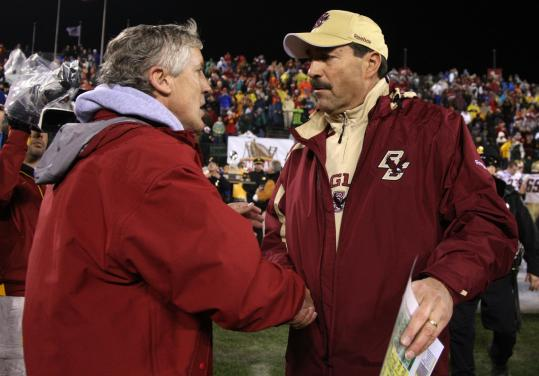 BC coach Frank Spaziani (right, with former USC coach Pete Carroll at last year's Emerald Bowl), is in favor of playing as many games as possible — but is that really a good idea?