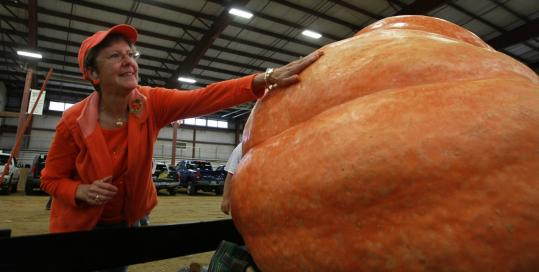 Rose Landry patted the pumpkin that her longtime partner, Al Boudreau, entered in the contest. It weighed 1,470 pounds, good for second place.